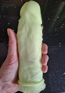 Holding the finished product of the clone-a willy kit, a pretty accurate reproduction of the model's penis