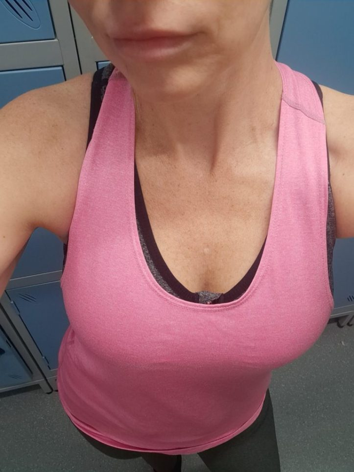 Pink top and pink sports bra, bright colours to help stand out for flirting at the gym and practicing gym pick up techniques