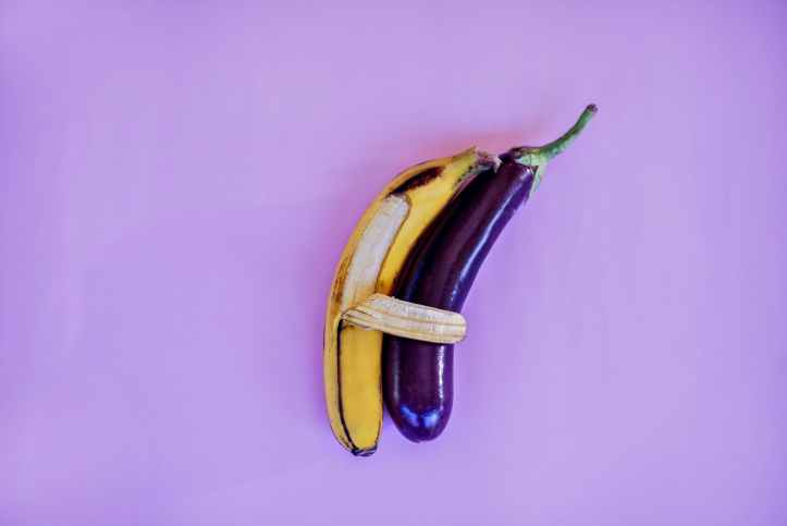 banana and eggplant on violet surface.  Much nicer than dick pics