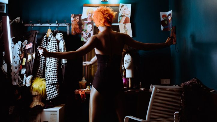 unrecognizable extravagant woman lacing corset on bodysuit in dressing room - All things worn provide the option to buy and sell all sorts of used clothing and shoes for fetishists