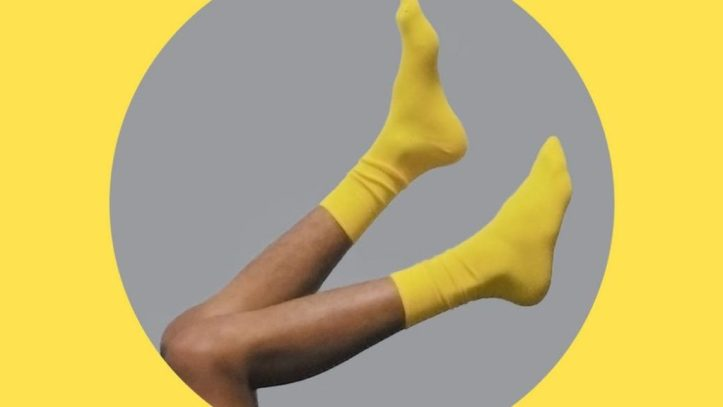 legs of crop person with socks.  Would you sell your smelly old socks on all things worn?  How much would you make?