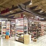 Universal Custom Display UCD In Grocery Supermarket Showcasing Wine Racks In Wine Cellar