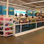 Retail Store Custom Display Cases In Cashier Checkout Line With Candy And Accessories To Purchase While Customers Wait In Line