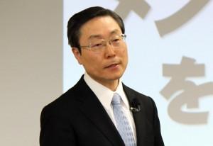 講話をする田中富広副会長