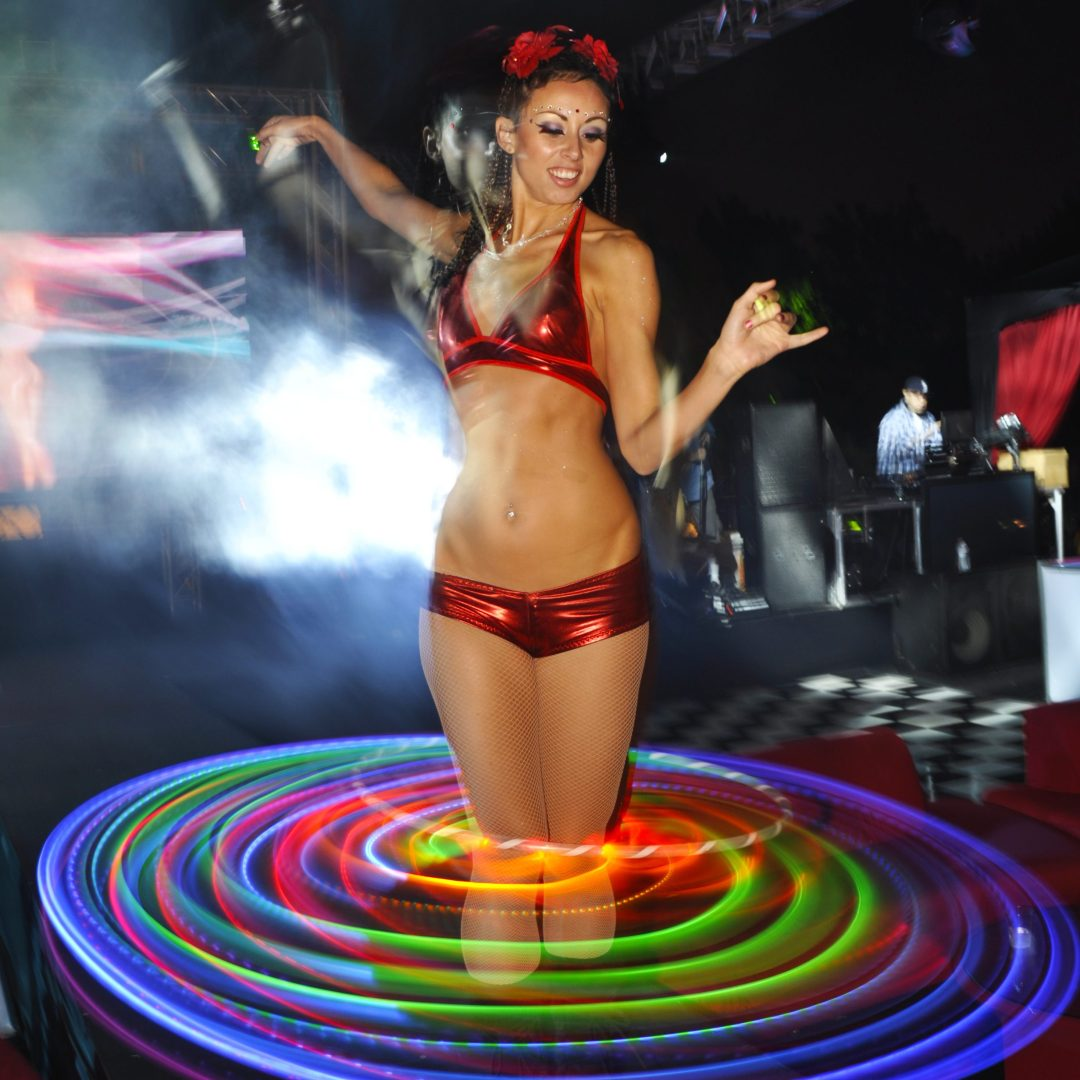San Diego hoop dancer spins LED hoop around her knees