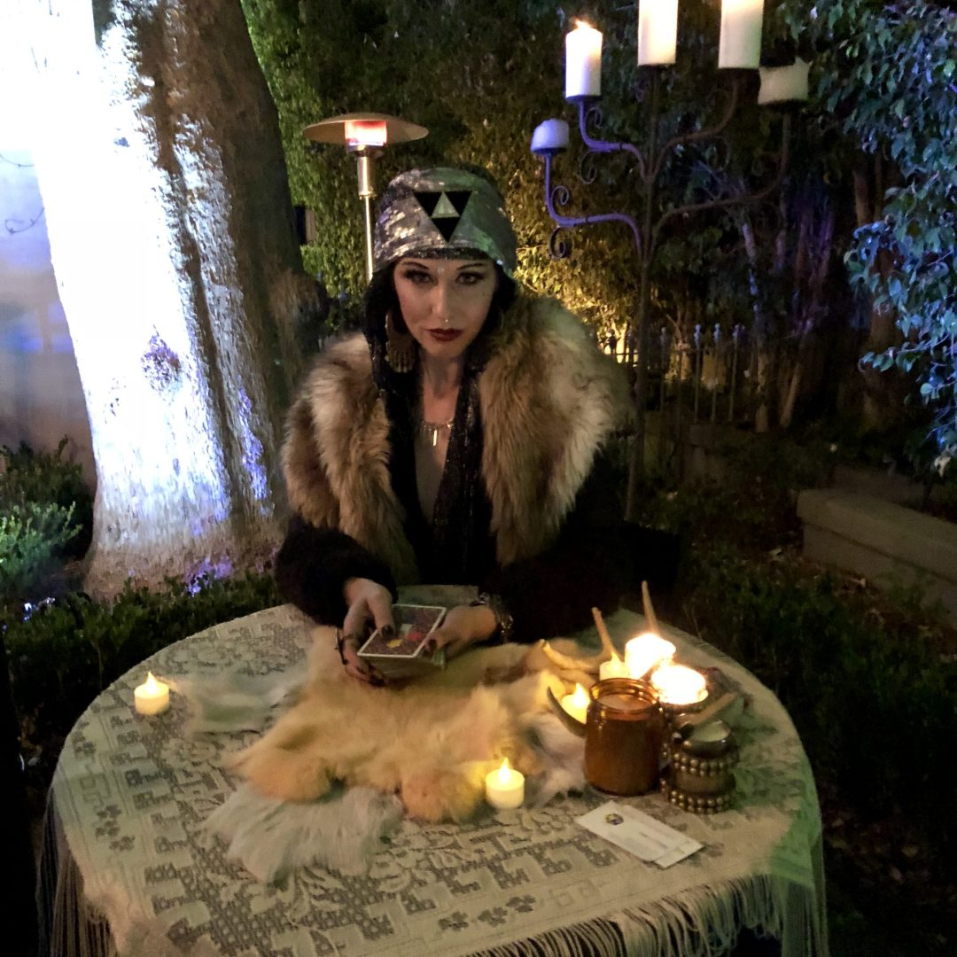 Fortune teller sits at table