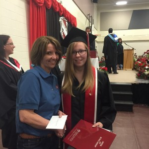 Lindsay Cheek receiving her Scholarship from Committee member Faith Chaisson