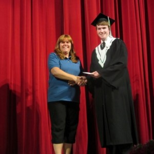 Ben Wanamaker receiving his Scholarship from Committee member Kelly Mauger