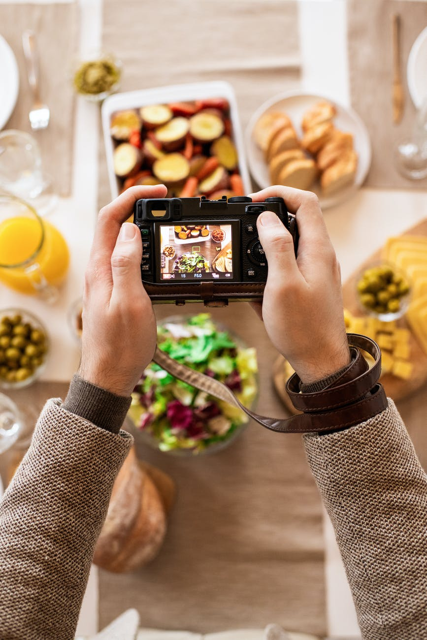 person taking photos of food