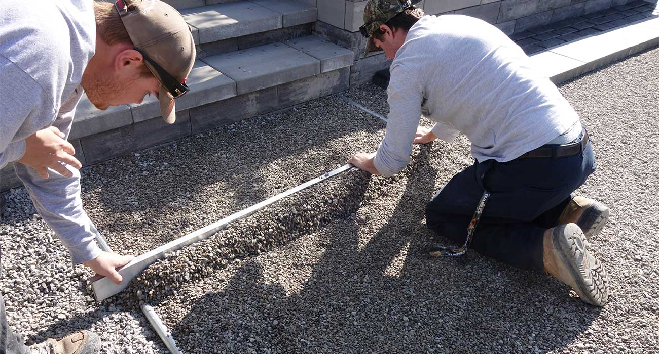 how to lay patio pavers on dirt unilock