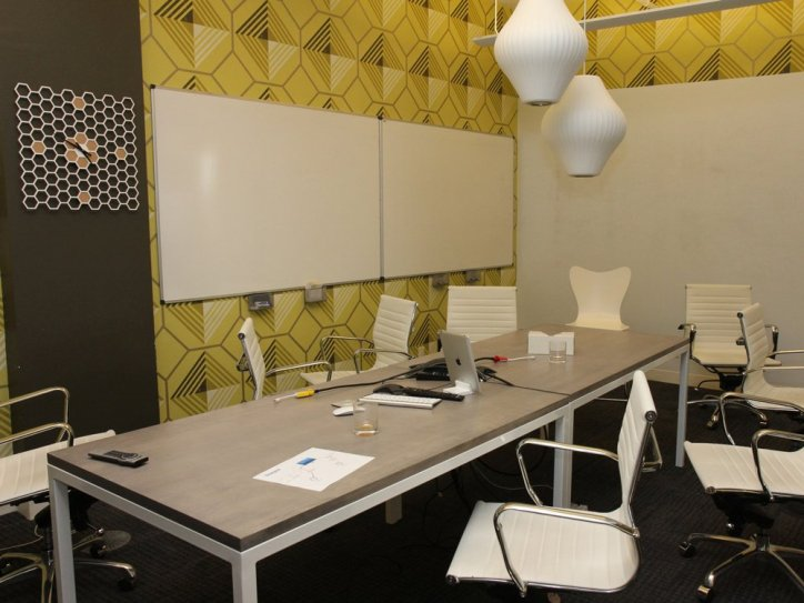 this-is-the-swarm-conference-room-right-after-a-product-meeting-its-decorated-like-a-beehive-and-honeycomb