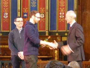 The VC presents the prize for the best poster. Photo: Will Carpenter