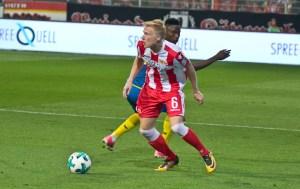 Pedersen spins around his opponent