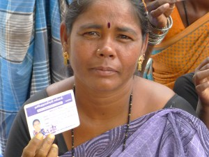Raja Lakshmi, President of Gypsy Craft Cooperative, with membership card