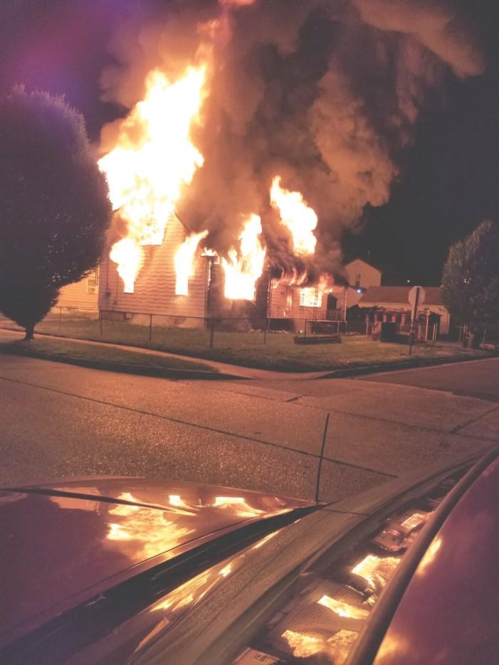 Suspicious fires erupt mile apart