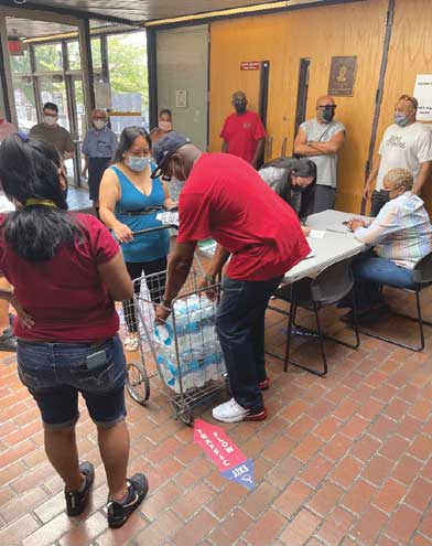 Roselle distributes bottled water to residents and seniors