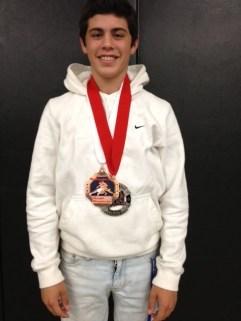 Junior Godinho medals at Fargo