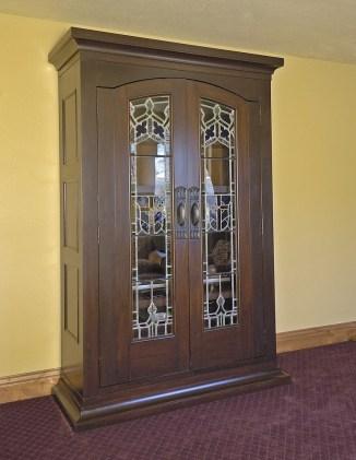 Repurposing antique doors to house a modern TV