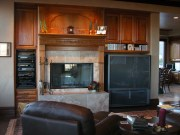 Cherry wood cabinetry & mantel with carved accents.