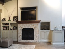 Cherry mantel with stone face, Inset TV above. Inset AV cabinet