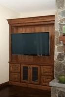 Inset alder wood wide screen TV cabinet. Oil rubbed bronze wire mesh door panels.