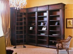 Dark red mahogany library cabinets with custom rolling ladder