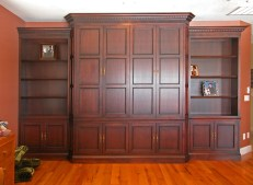 Mahogany TV cabinet & bookshelf. Bi-fold pocket doors. Glazed & shaded finish.