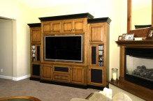 Cherry wood cabinet with black accents.