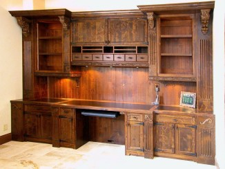 Rustic Alder Desk with LED illumination, motorized monitor lifts, table in a drawer.