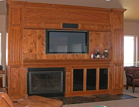 Knotty Alder wood wall unit for fireplace; TV & AV system.