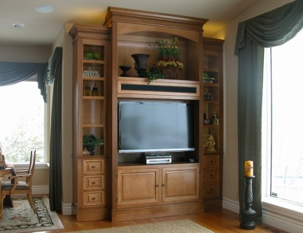 "112"" high TV & display cabinet with LED illuminated interior."