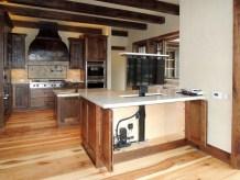 Motorized TV lift installed into kitchen cabinet peninsula.