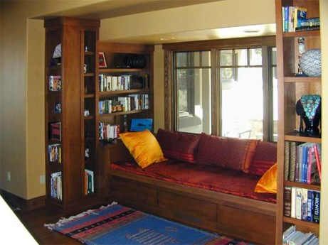 Quarter sawn oak window seat and bookshelves with drawer storage below seat