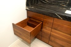 Dovetailed drawers with electrical outlets and adjustable dividers