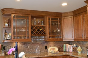 Full overlay maple wood cabinets with adult beverage and vessel storage