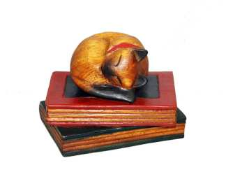 Carved Cat Curled on Book