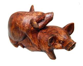 Carving of Pigs Making Bacon