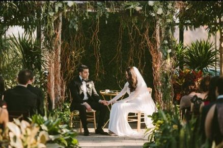 Overgrown Garden Wedding Altar with Vines and Greenery – shared in a roundup post on Huffington Post