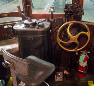 Control cab. There is one at each end of the cars so they can go either way without turning around. The large brass wheel is the standing brake.