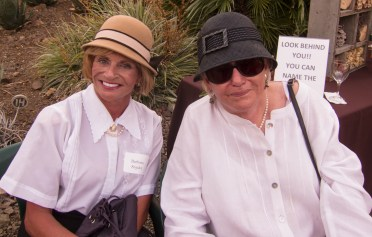 The cloche hat will always be in style for these two.