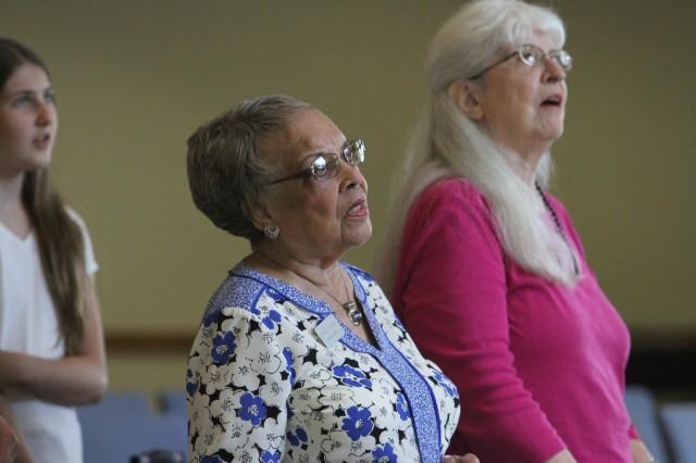 Two women singing in church