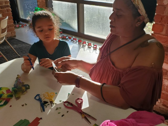 Parent and child making crafts together