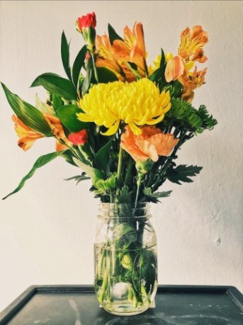 Orange and yellow flower arrangement