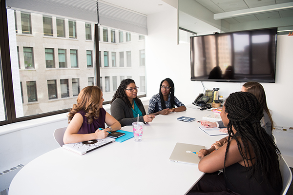 windrush compensation team in a meeting
