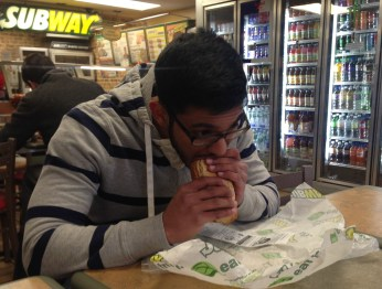 Melvin Mehidi, a Sophomore at Hofstra University eating at a Subway restaurant located outside of campus.
