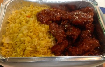 One of the many types of food that Lackmann provide. ( fired rice with sesame chicken)