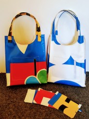 Tote bags with phone pockets and zippered pouches handcrafted for White Horse Style from reclaimed vinyl banners.