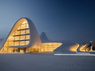 the-619000-square-foot-heydar-aliyev-centre-opened-in-baku-azerbaijan-and-won-the-london-design-museum-award-in-2014-like-many-of-hadids-extravagant-buildings-it-had-a-hefty-price-tag-25