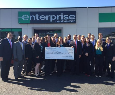 Enterprise employees present their 2015 campaign check.