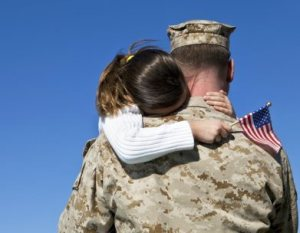 veteran_with_child_holding_flag_newsletter-392x304